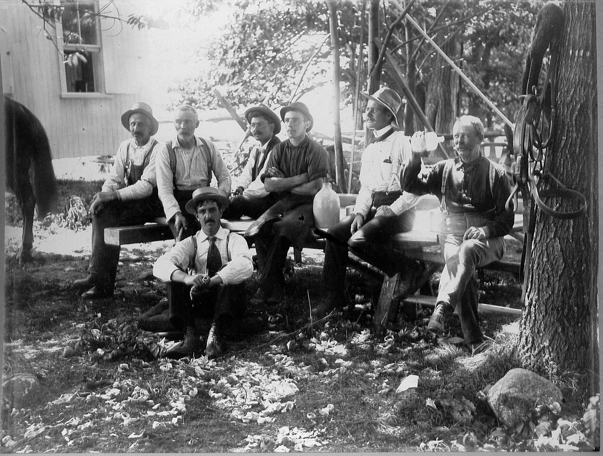 Men sitting on benches celebrating